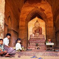 Buddha image and small children.