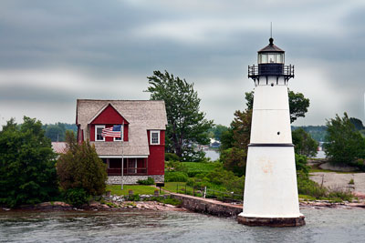 Thumbnail image ofWindswept house with lighthouse on the St. Lawrence...