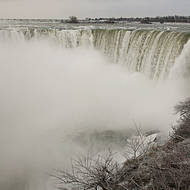 Very cold Horseshoe falls section of Niagara falls in mid-winter.