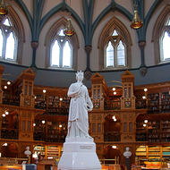 Queen Victoria standing in the Library of Parliament in Parliament Hill