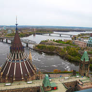 View of the cupola of the Library of Parliament and downstream Ottawa River and Alexandra Bridge from the Peace Tower.