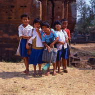 Curious children in the grounds of an old temple complex.