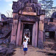 Children exploring a collapsing pagoda.
