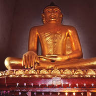 Three lit; large Buddha image.