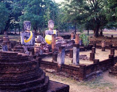 Thumbnail image ofReclining and sitting Buddha images.