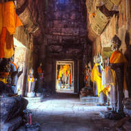 Inside old pagoda with many Buddha images.