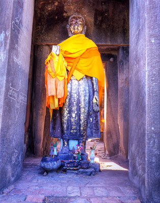Thumbnail image of Standing Buddha image in the doorway of old pagoda.