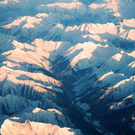 Snowy Rocky Mountains from the air.