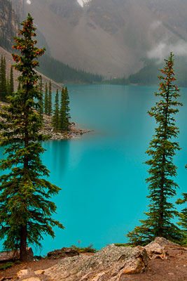 Thumbnail image ofEntrancing colors of misty Moraine Lake in the...