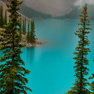 Entrancing colors of misty Moraine Lake in the Canadian Rockies.