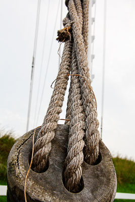 Thumbnail image ofWeathered hemp rope holds a signal mast at the...
