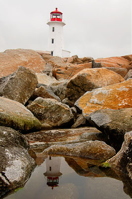 Thumbnail image ofPeggy's Cove lighthouse reflected in the tidepool.