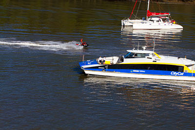Thumbnail image of City Cat commuter transport and a jet skier on...