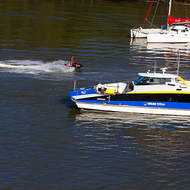 City Cat commuter transport and a jet skier on the Brisbane River.