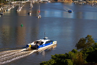 Thumbnail image ofCity Cats pass to port on the Brisbane River.