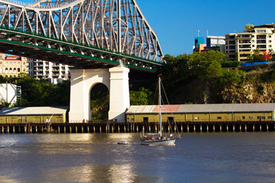 Thumbnail image of Yacht motoring down the Brisbane River under the...