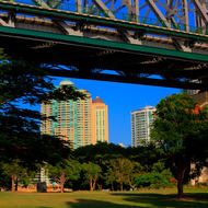 Under the Story Bridge beside the main weight bearing pier towards downtown Brisbane.
