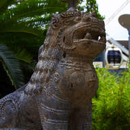 Guardian lion at the Nepal Peace Pagoda with the wheel of Brisbane in the background.