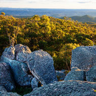 Granite boulders overlook the rolling countryside.
