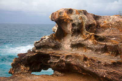 Thumbnail image of Weathered rock and the sea which weathers it.