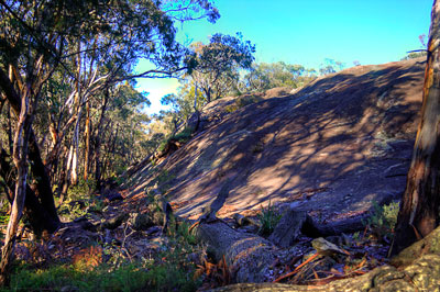 Thumbnail image ofCold granite outcrop in the cold blue light of...