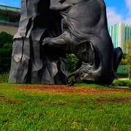The World Turns, elephant sculpture at the Gallery of Modern Art with the State Library of Queensland in the background.