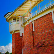 The rear wall and the guard observation tower of the Old Boggo Road jail.