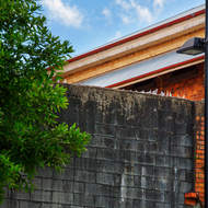 Wall breech topped with broken glass, Old Boggo Road jail.