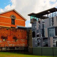 Cell Block D and external observation tower, Old Boggo Road jail.