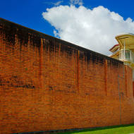 The side wall and the guard observation tower of the Old Boggo Road jail.