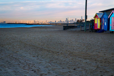 Thumbnail image ofBeyond the bathing boxes the sun lights up downtown...
