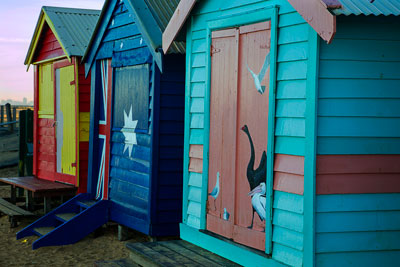 Thumbnail image ofEnd of the row, bathing boxes as sunrise hits...