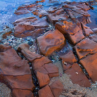 Line, shape and texture of sand, rocks and tidal pools.