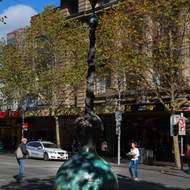 Police stand watch over the strange octopus thing on Flinders Street.
