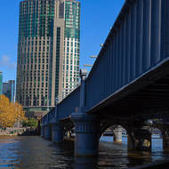 Old railway bridge, now pedestrian bridge, over the Yarra River leading to the Crown casino.