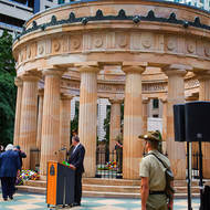 Service at the ANZAC memorial, New Zealand flag at half-mast.