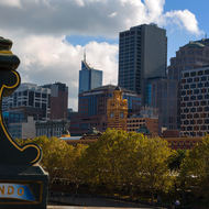 Downtown Melbourne fronted by Flinders Street railway station from Princes Bridge.