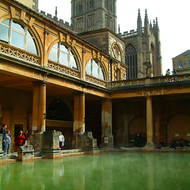 Steam rises from the heated water of the Roman baths.