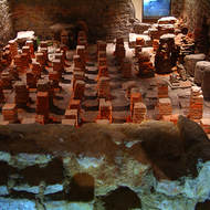 Early heating system, air passages to circulate warmed air under the floor in the Roman baths.