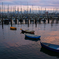 Sun rise over yachts moored at the Royal Melbourne Yacht Squadron.