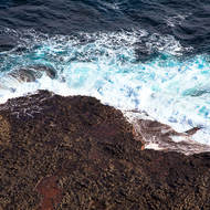 Looking down at the turbulent sea from the base of Cape Schanck lighthouse.