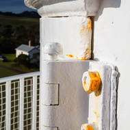 Many coats of paint and still rusty, the door hinge of the upper inspection platform of Cape Schanck lighthouse.