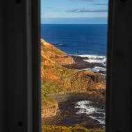 View south of Bass Strait and Cape Schanck from a window in the tower of Cape Schanck lighthouse.