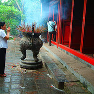 Incense burning and devotionals at the temple on turtle island.