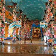 Long view inside the Cao Dai temple to the altar and the Divine Eye.