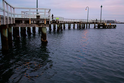 Thumbnail image ofDawn over Port Melbourne pier and fishers.