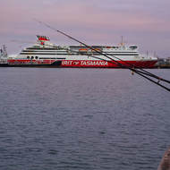 Refuelling tender pulls up alongside the Spirit of Tasmania ferry.