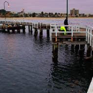 Very quiet, very still as dawn breaks over Port Melbourne pier.