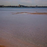 Port Melbourne pier and the shallows of Port Melbourne beach.
