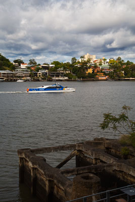 Thumbnail image of CityCat passenger ferry motoring up river in front...